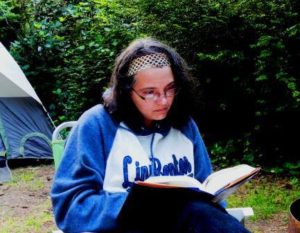 Photo of Larina studying while camping